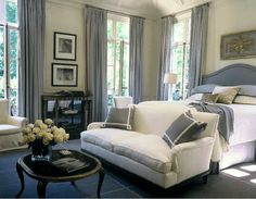 Gorgeous serena monochromatic bedroom by Suzanne Kasler. Love the sofa at the end of the bed instead of the usual bench.