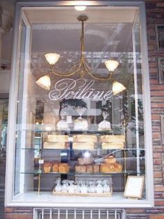 "Poilane is a world famous bakery  300 year old oven"" footballs""  since 1932  8 rue du Cherche-Midi"