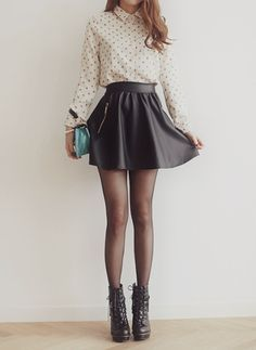-cute white polka dot button down longer sleeve, black leather skater skirt, sheer black tights, black booties fall/winter outfit-