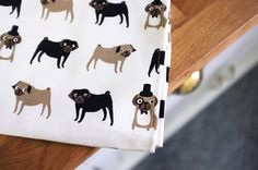 pug print tea towel by fenella smith   notonthehighstreet.com