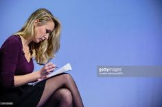 French Deputy Marion Marechal Le Pen is writing her speech Before climbing onto the platform to speak it during the 'Assises de la présidentielle' at the Cite internationale on February 4, 2017 in Lyon, France. Nearly 3000 supporters came to listen the political program of French far right National Front (FN) political party's leader, Member of the European Parliament, and candidate for the 2017 French Presidential Election Marine Le Pen, titled '144 Presidential Commitments'.