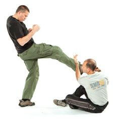 Israeli Martial Arts: Krav Maga Expert Eyal Yanilov Shows You How to Disable an Opponent and Defend Yourself From the Ground --- You're on the ground. An attacker launches a front kick at you. What do you do? In this exclusive video, respected krav maga master Eyal Yanilov shows you a technique which may allow you to open up an escape route and emerge unharmed. #blackbeltmagazine #martialarts #kravmaga #groundfighting #selfdefense #kravmagavideos #eyalyanilov #israelimartialarts