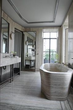 Glam marble bathroom with a free-standing marble tub.
