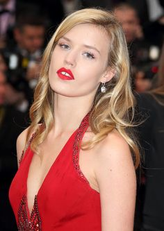 Georgia May Jagger in hot red lipstick and loose waves at the Cannes Film Festival. Sultry siren, indeed!