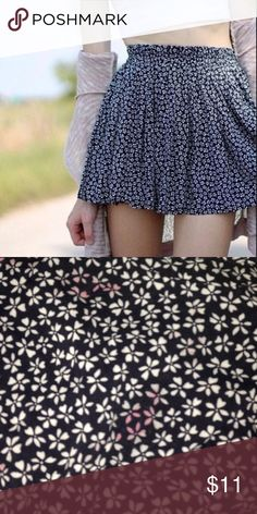 Brandy Melville Flower Skirt Flowy little Brandy Melville flower skirt. Super cute, washed but never worn. Has a couple light red stains (lipstick mishap in the dryer), but otherwise in good condition. Since skirt is flowy, the stains aren't too noticeable. No holes or rips. Accepting reasonable offers due to stains! Brandy Melville Skirts Mini