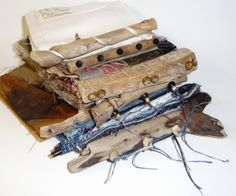 Noela Mills  Fabric books with driftwood spines