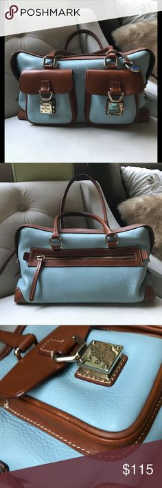 """Dooney & Bourke  sky blue Leather shoulder bag Beautiful sky blue trimmed in a sport brown leather . Locking quality front pockets  back zipper pocket. Pink mesh interior key fob cell pocket. Zip pocket. Pre loved. Please see pictures. A small interior mark from the feet of the bag. A scuff on top not noticeable a scuff on left front trim pocket.  13"""" width 7"""" height Dooney & Bourke Bags Shoulder Bags"""