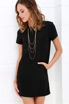 You're definitely starting your day off right when you step out the door in the Have a Good One Black Shift Dress! Darted bodice is framed by a rounded neckline and short sleeves, all made of medium-weight woven poly fabric. Angular seaming at the waist creates stealthy diagonal welted pockets above a relaxed, shift silhouette. Hidden back zipper and clasp.