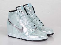 With the comparisons that have been made to the very similar Air Max 1, this newest Nike WMNS Dunk Sky Hi is eligible for 'Disco Ball' and 'Silver Reptile' nicknames. Both accurately describe the look of this shimmering wedge sneaker, … Continue reading →