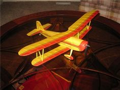 The Inspirer Biplane is a free flight design that was converted to 3 ch. R/C using the gear motor and battery from the Park Zone P-51 and the radio brick from the Vapor. Built by Wayne Greffon.
