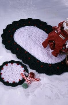 Christmas placemats and coasters crochet pattern. This looks like a set my late mother-in-law made for me.  I cherish that set, so it would be fun to make a new set to hand down to my daughter.