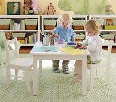 I love the My First Table & Chairs on potterybarnkids.com  Will go great with her kitchen set.