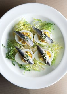 Deviled Eggs with white anchovy filet. Making there for Easter, because I can do nothing simple.