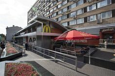 The oldest of Moscow's McDonald's outlets, which was opened on Jan. 31, 1990, is closed on Thursday, Aug. 21, 2014. Russian news agencies reported Thursday that the country's food safety agency will conduct checks on McDonald's restaurants in the Urals following food safety complaints, a day after four branches of the chain were shuttered in Moscow. (AP Photo/Alexander Zemlianichenko)