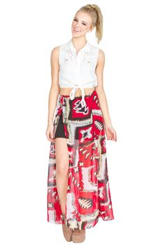 The Sugarlips Road Less Traveled Skirt is a multicolored tribal print maxi skirt featuring two high front side slits that will move beautifully as you walk. Black slip included underneath. Pair it with a black crop top to complete the look. #MyLuluCloset #Sugarlips #Storenvy #Sales #Skirts