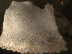 So this one started out as my sister finding this picture of a lovely blanket and wanted me to duplicate it for a gift. It isn't my original idea and I couldn't find the pattern listed in my usual hunting…Read more Granny Square and Ribbon Baby Blanket Set ›