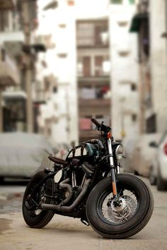 I like this motorcyle a lot, mixing the style of a cafe racer and a bobber makes for a sweet looking, and likely still fun to ride, custom hardtail.