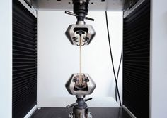 Hebel's team uses a machine to test the tensile strength of bamboo composite material samples, which he says could replace steel as the dominant construction material