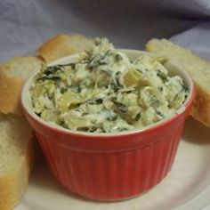 """Hot Artichoke and Spinach Dip II   """"Who can deny the popularity of artichokes and spinach blended with cheeses? Try this hot, flavorful dip with toasted bread or tortilla chips."""""""