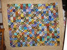 another memorial quilt made from scrub tops and quilt fabrics. this was a McCall's Quilting magazine pattern.