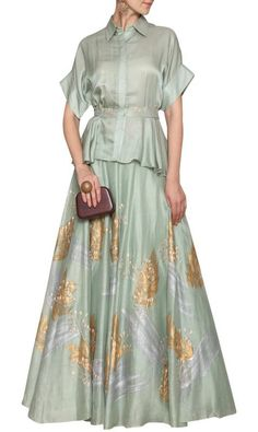 79ad5fecffcf7a Devnaagri Featuring a sea green top in cotton silk satin base with kasab  embroidery on the waist belt and high-low flare at the bottom.