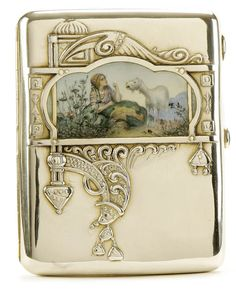 FABERGE SILVER AND PAINTED ENAMEL CASE, in art nouveau style. Moscow The polished silver case in the Pan Slavic style. The lid decorated with repousse design encircling a matte-finish enameled miniature painting of a young maiden with baby goat Silver Enamel, Antique Silver, Art Nouveau, Vintage Cigarette Case, Cigarette Box, Russian Art, Russian Style, Baby Goats, Faberge Eggs
