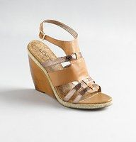 """Holly Wood Wedges - We mixed up shimmery details with low-key accents—like jute and wood—for fun, relaxed allure. Adjustable buckle at ankle.  Jute trim. Cork print footbed. 4"""" wooden heel."""