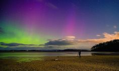 Tasmania's skyline has been aglow in recent days – with vivid purple and green lights illuminating the horizon – following a huge explosion of magnetic field and plasma from the Sun's corona