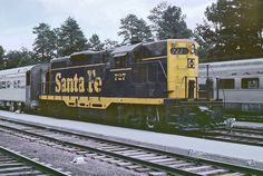 https://flic.kr/p/Yns5Vf | My First Time At Grand Canyon Station ... | ... and Santa Fe treated me to two trains. The Geep 9 that shuttled cars back and forth to Williams Junction on the mainline to add and retrieve coaches and Pullmans from the eastbound and westbound trains named the Grand Canyon that made nocturnal stops. And a few cars were on the station tracks that would go down to Williams Junction that night. And a large passenger extra was in the station with warbonnet F-units.