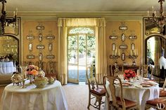Majolica plaques ornament the walls of a dining room; the furnishings are antique.
