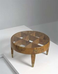 GIO PONTI Coffee table, from the RAI Headquarters, Milan, Italy, ca. 1939  Walnut root-veneered wood, glass, brass. 16 in. (40.6 cm) high, 28 5/8 in. (72.7 cm) diameter Produced by Giordano Chiesa, Italy