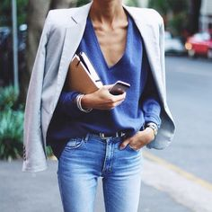 blazer, v neck sweater, faded blue mid rise jeans; casual
