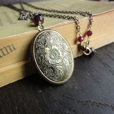 Long Vintage Picture Locket Necklace in  Antique Brass with Delicate Floral Motif - Oval