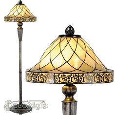 Tiffany Vloerlamp Filigrees  Een bijzonder mooie vloerlamp. Helemaal met de hand gemaakt van echt Tiffanyglas. Dit originele glas zorgt voor de warme uitstraling. De voet is vervaardigd van bronskleurig metaal. Met 2x grote fitting (E27). Met schakelaar aan het stroomsnoer. Afmetingen: Hoogte: 168 cm Diameter Kap: 46 cm