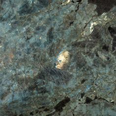 Aphrodite, natural stone granite from Madagascar, has cool tones of blue and green with black. Arizona Tile carries Aphrodite in natural stone granite slabs.