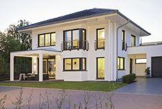 Energiesparhaus Stadtvilla mit Garage City Life - Haus 250_WeberHaus - Designhaus modern Walmdach Solarplatten Fassade Putz Terrasse Pergola - Grundriss Haus Ideen auf HausbauDirekt