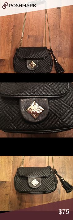 Bcbg black and gold leather purse Really fun bag! I only needed it for a wedding so I would like to give a new home! Very clean on the inside goes with everything and basically new! BCBG Bags Shoulder Bags