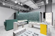 loosely knitted wiring in teal blue adds texture to the interior of eyeglass store in seoul by wallga + WGNB