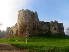 Chepstow Castle (Welsh: Cas-gwent), located in Chepstow, Monmouthshire in Wales, on top of cliffs overlooking the River Wye, is the oldest surviving post-Roman stone fortification in Britain.[1] Its construction was begun under the instruction of the Norman Lord William fitzOsbern,[2] soon made Earl of Hereford, from 1067, and it was the southernmost of a chain of castles built along the English-Welsh border in the Welsh Marches.