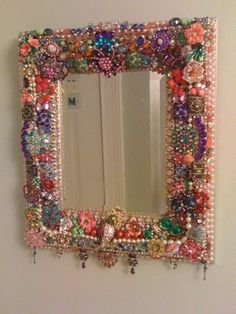 mirror decorated with extra beads and baubles fun!! I would do this but then spray paint it all one matte color to make it look more modern and sleek