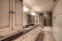 Country Full Bathroom with MS International Lagos Blue Limestone, limestone tile floors, ceramic tile floors, Complex Granite