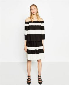 This back and white striped off-the-shoulder blouse from Zara can be worn with a skirt or jeans.