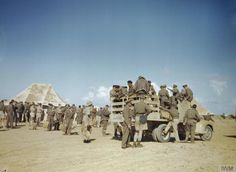 THE ROYAL CANADIAN AIR FORCE IN TUNISIA, 1943Aircrew, possibly of No 417 Squadron, Royal Canadian Air Force, climb into a truck which will take them to their dispersal point. Possibly taken at Goubrine, Tunisia.