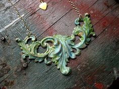 Large Verdigris Brass Leaf Flourish Statement Necklace 14k Gold Filled Chain, Gift for Her, Accessories by studioCjewelry on Etsy https://www.etsy.com/listing/223780632/large-verdigris-brass-leaf-flourish