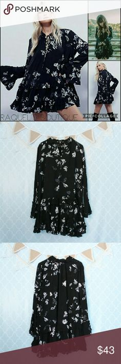 Black Floral Sunset Tunic Dress Details: Black floral drop waist frill billowy tunic dress with tie high neck  Brand: Boutique Brand  Size: Small Measurements: Bust/38-40 inches   Length/31 inches  Size: Medium Measurements: Bust/40-42 inches   Length/31 inches  Size: Large Measurements: Bust/42-44 inches?  Length/32 inches  Condition: New and packaged Dresses