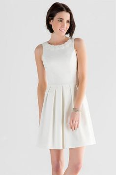 """The Shyanne Embellished Bow Dress is perfect for the bride-to-be! This white textured dress is decorated with flowers & pearls along the neckline & finished with a bow in the back.<br /> <br /> - 34.5"""" length from shoulder to hem<br /> - 34"""" chest<br /> - 26"""" waist<br /> - 60"""" sweep<br /> - measured from a size small<br /> <br /> - Self: 95% Polyester, 5% Spandex; Lining: 100% Polyester<br /> - Dry Clean Only<br /> - Imported"""