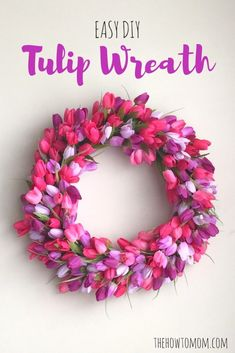 Easy DIY Tulip Wreath - with pink and purple tulips. Oh my gosh, these are so stunning. And super cheap, for real. Take the time to really look at all the different versions and color schemes. Would be a really fun one to do with friends & then also do o Diy Spring Wreath, Spring Crafts, Diy Wreath, Wreath Making, Door Wreaths, Wreath Ideas, Yarn Wreaths, Burlap Wreaths, Wreath Hanger