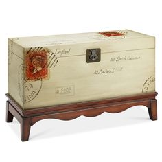 This antiqued white with walnut base accent trunk featuring its vintage postage stamp motif is a selection that is a true treasure rich in Old World traditions.