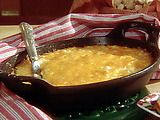 Paula Deens baked cheese spread    Ingredients  2 cups mayonnaise   2 cups grated Colby cheese   2 cups chopped onion   Dash hot red pepper sauce   Dash Worcestershire sauce  Directions  Preheat oven to 350 degrees F.   Mix all ingredients together and place in a pie plate or any baking dish. Bake until golden brown on top, approximately 30 minutes. Serve with crackers or bagel chips.