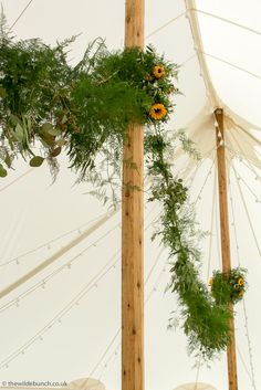 Top Bristol wedding florists, The Wilde Bunch adding a touch of aerial 'wow' to a summer marquee with a 25 meter hanging garland.It's always the first thing to get guests comments in any marquee design. Hanging Garland, Marquee Wedding, Florists, Bristol, Wedding Flowers, Touch, Wreaths, Weddings, Garden